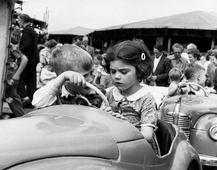 Two children on a ride at the Hampstead Heath fair: 20th century