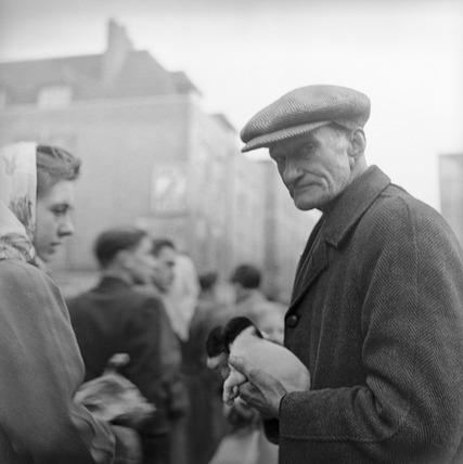 A trader at Petticoat Lane street market: 1952