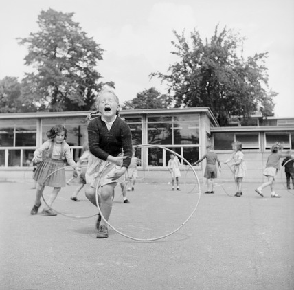 Children in school playground: 1957