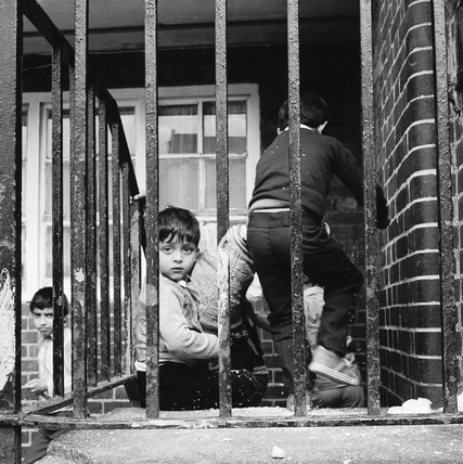 Children play outside their homes near Brick Lane: 1983