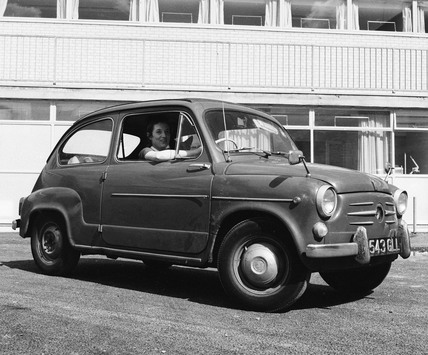 Nurse driving a Fiat 500: 20th century