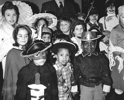 Children attend a New Year party at a community hall in Barnet: 1980