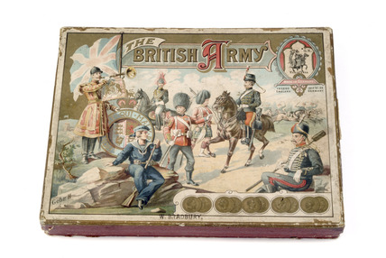 An illustrated box containing toy soldiers and accessories: C. 1890