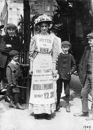 Photograph of a suffagette demonstrating at the Strand: 1909