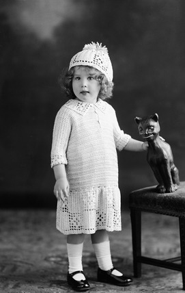 Image of a child modeling knitwear: 1922