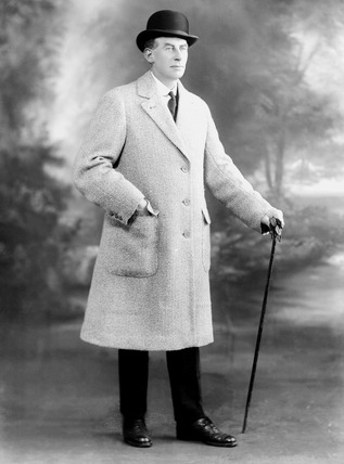 Image of a man modeling outerwear for Waterlow & Sons Limited: 1924