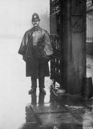Policeman standing guard: 1912