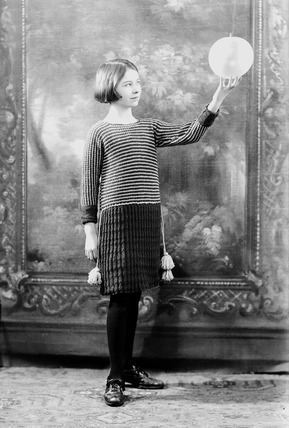 Image of a child modeling knitwear: 20th century