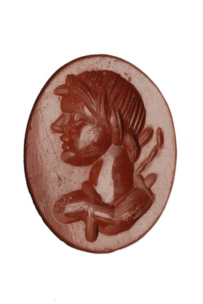 Roman intaglio with the face of a youthful satyr