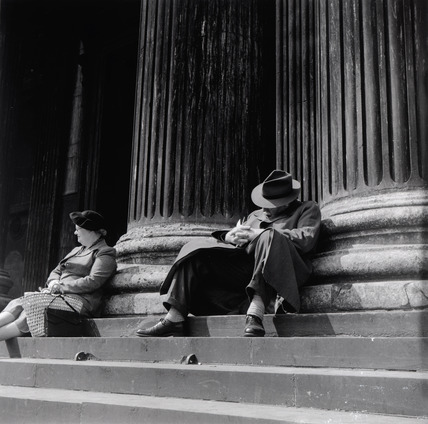 Passers-by rest on the steps of the University of London's main building: 1952