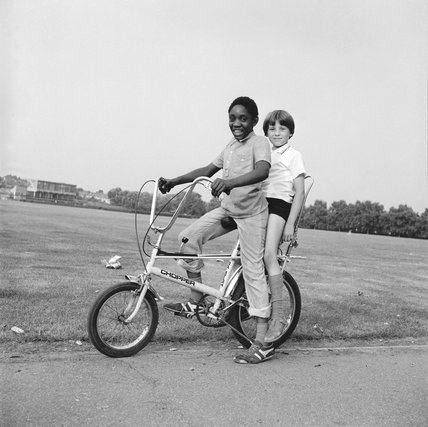 Two boys riding a bicycle: 1973