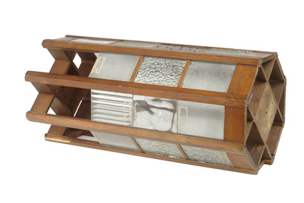 Wooden framed display unit with panels of glass: 20th century