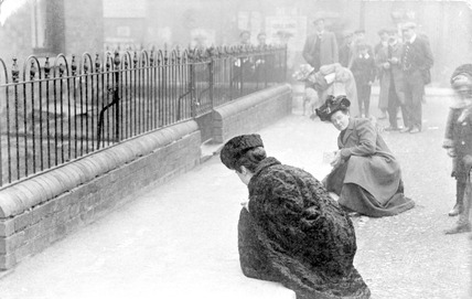 Suffragette Emma Sproson chalking a pavement: 20th century