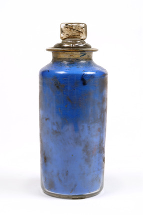 Glass jar containing sample of blue powder colour: 20th century