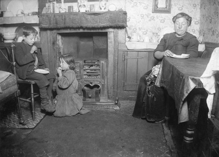Interior of a deprived home in Whitechapel: 20th century