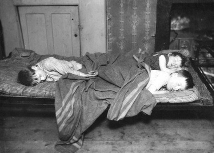Slum children in bed, Bethnal Green: 20th century