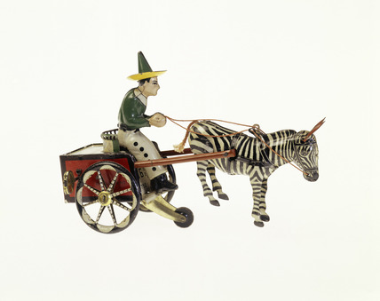 Clockwork toy figure and cart: 1927