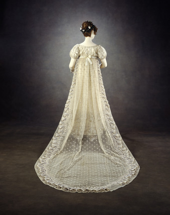 Back view of embroidered net dress with court train: 19th century