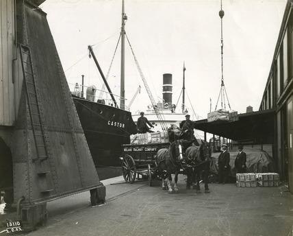 Unloading paper at Surrey Commercial Docks: 1922