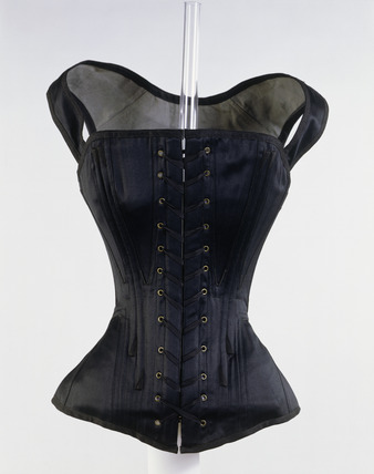 Black cotton long line corset, front view: 19th century
