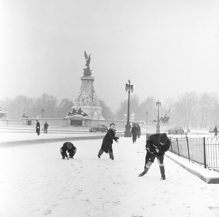 Children playing in the snow close to the Queen Victoria Memorial: 1957