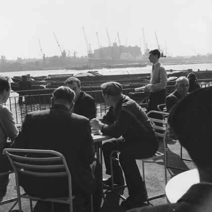 Dockers at lunchbreak by the Lower Pool of London: 1959