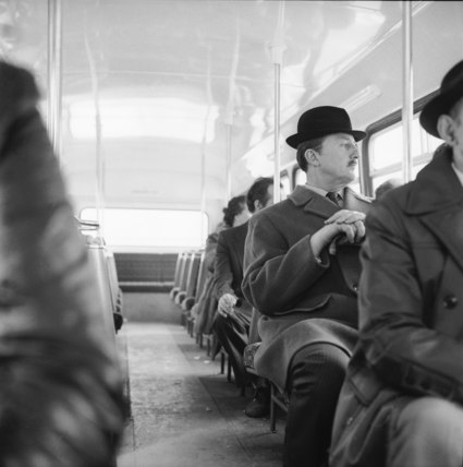 A City gent on the top deck of a London bus: 20th century
