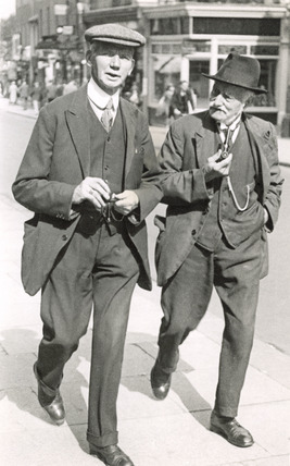 Two men, walking in Sutton High Street: 20th century