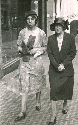 Two women, walking in Sutton High Street: