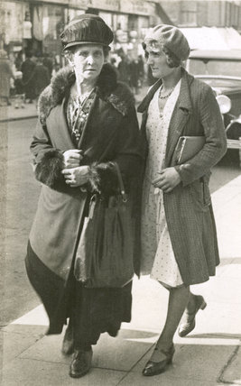 Two women, walking in Sutton High Street: 20th century