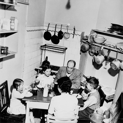 Family around kitchen table: 20th century
