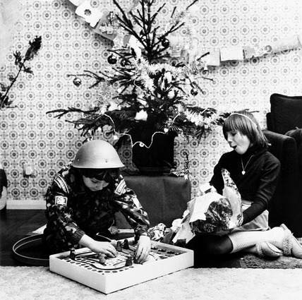 Children unwrap their Christmas presents: 1975
