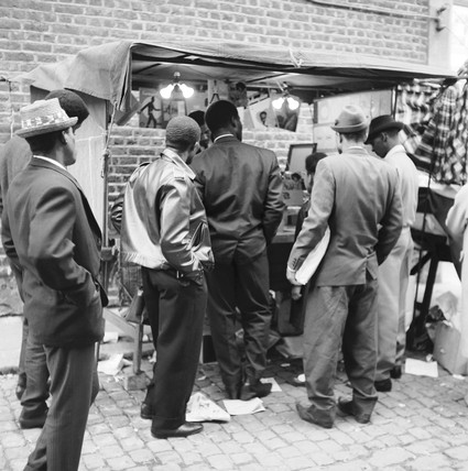 Group of men at a market stall, Portobello Road: 1960