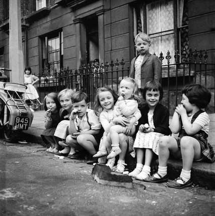 Children sitting on the curb, Maida Vale: 1960