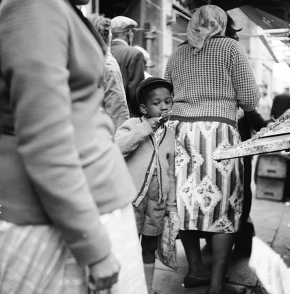Young boy in a market crowd, Portobello Road: 1960