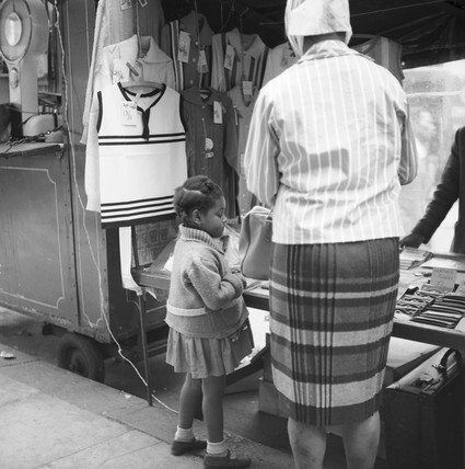 Woman and child at market stall, Portobello Road: 1960