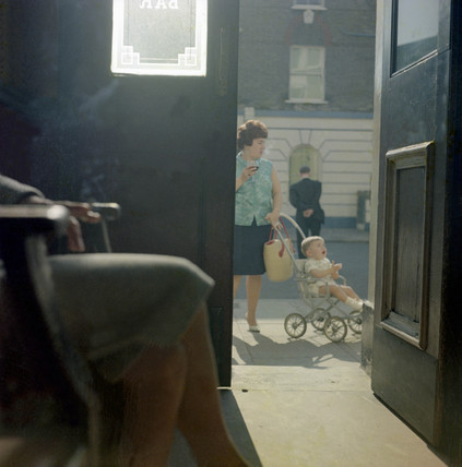Woman with a toddler seen from inside a pub, Maida Vale: 1960