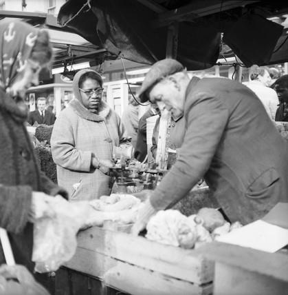 Shoppers at a market stall, Portobello Road: 1960