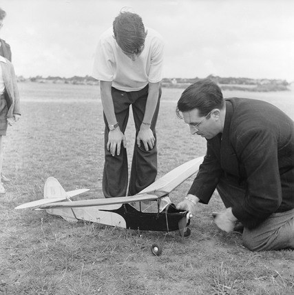 Man and boy with model aeroplane at Fairlop: 1952