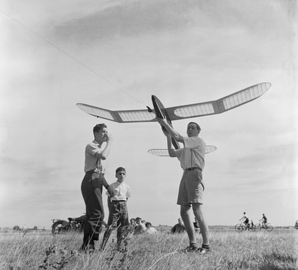 Young men with model aeroplane at Fairlop: 1952