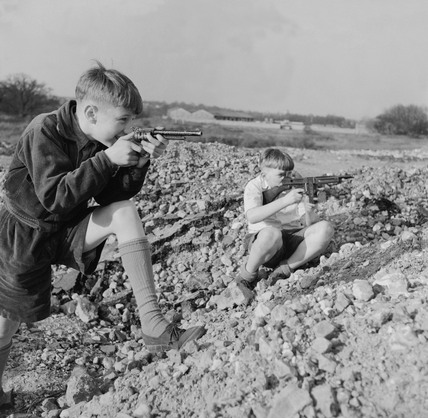 Two boys playing with toy guns: 1957