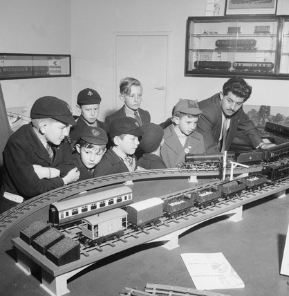 Boys admiring a train set: 1953