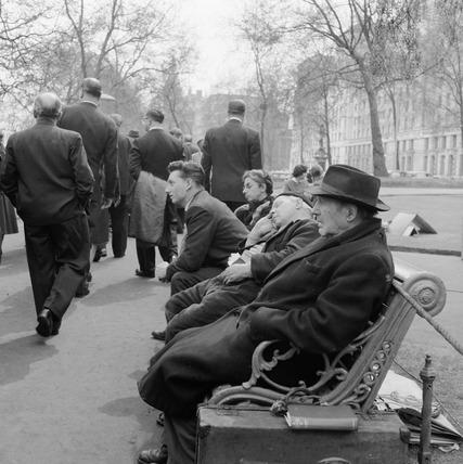 Men sat on a park bench: 1960