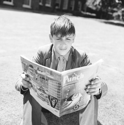 Schoolboy reading Punch magazine: 1964
