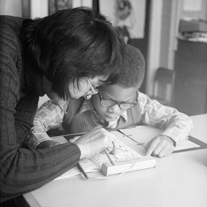 Small boy and his teacher reading: 1973