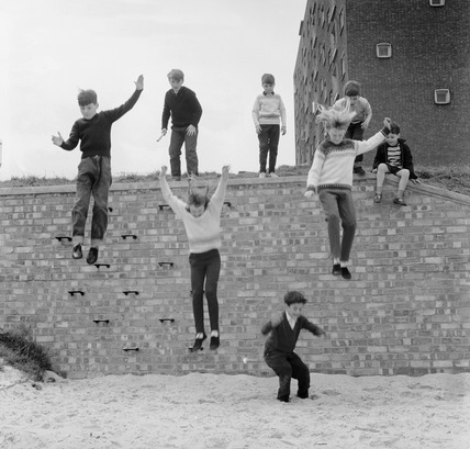 Children jumping off wall: 1965