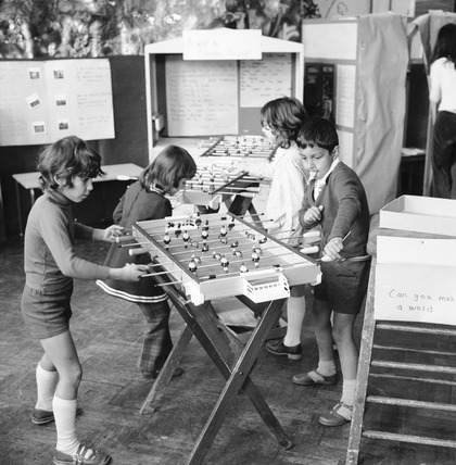 Children playing table football: 1973