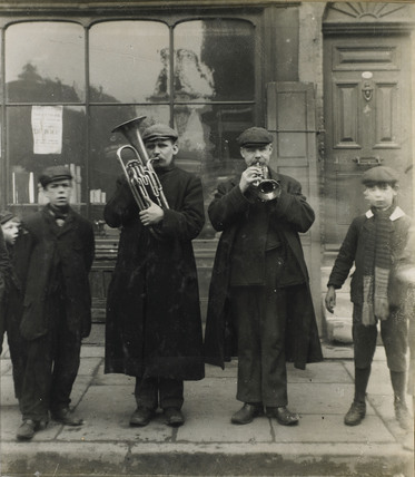 Two blind street musicians: c.1900