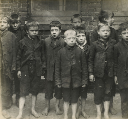 Poor boys in rags and barefoot: c.1900