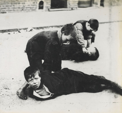 Boys playing prisoners: c.1900